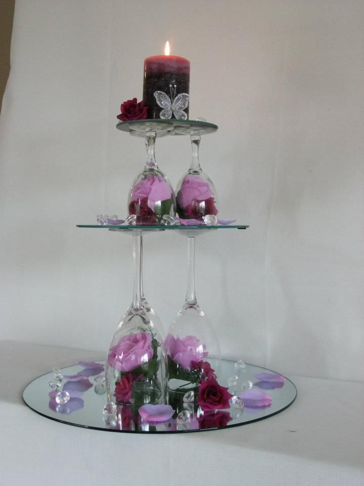Centerpiece made with wine glasses and mirrors wedding for Wine glass decorations for weddings