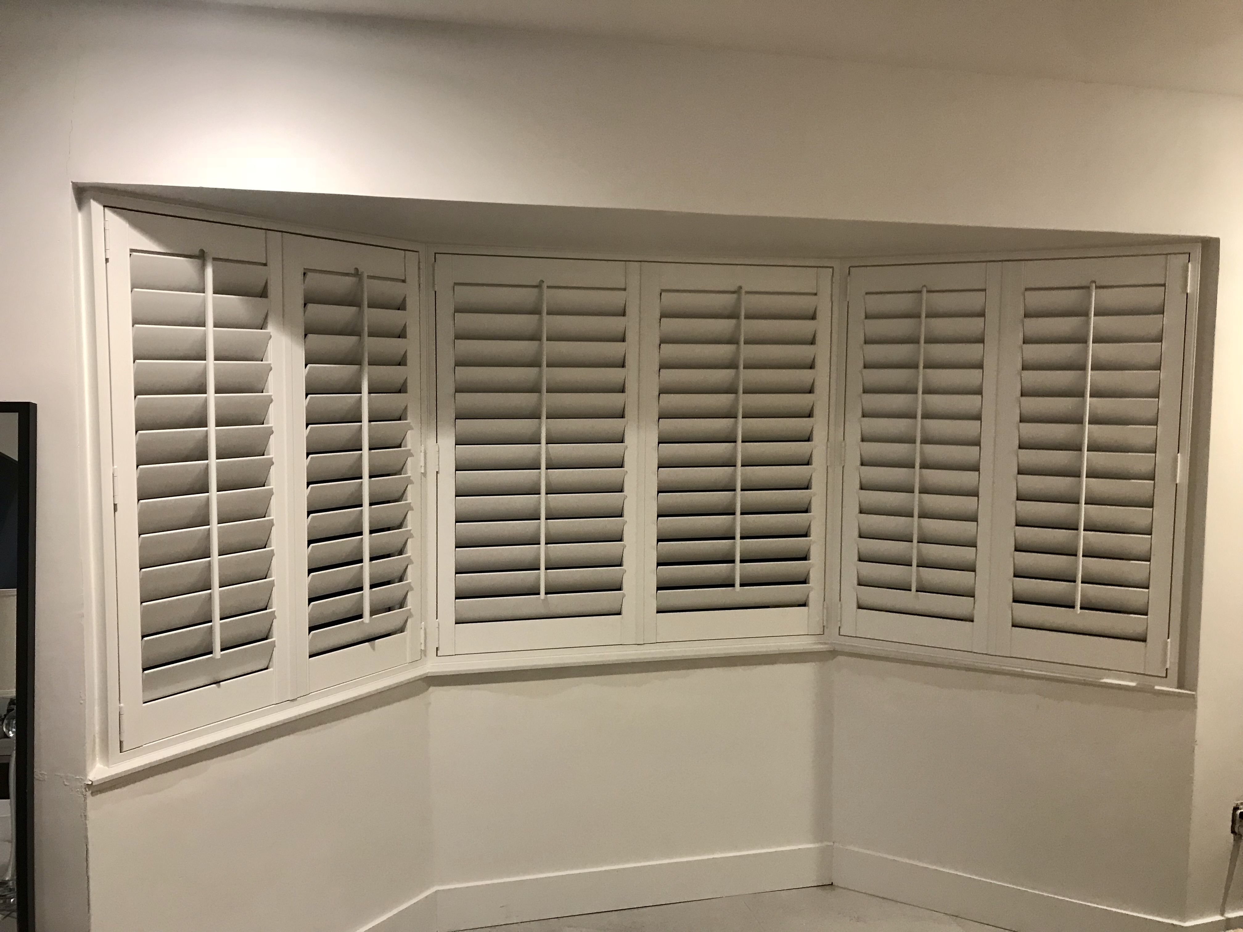 Bay window with plantation shutters by elite decor miami bay