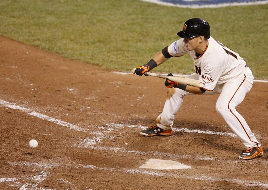 Giants Joe Panik hits a sacrifice bunt in the sixth inning during Game 4 of the World Series at AT&T Park on Saturday, Oct. 25, 2014 in San Francisco, Calif. Photo: Beck Diefenbach, Special To The Chronicle