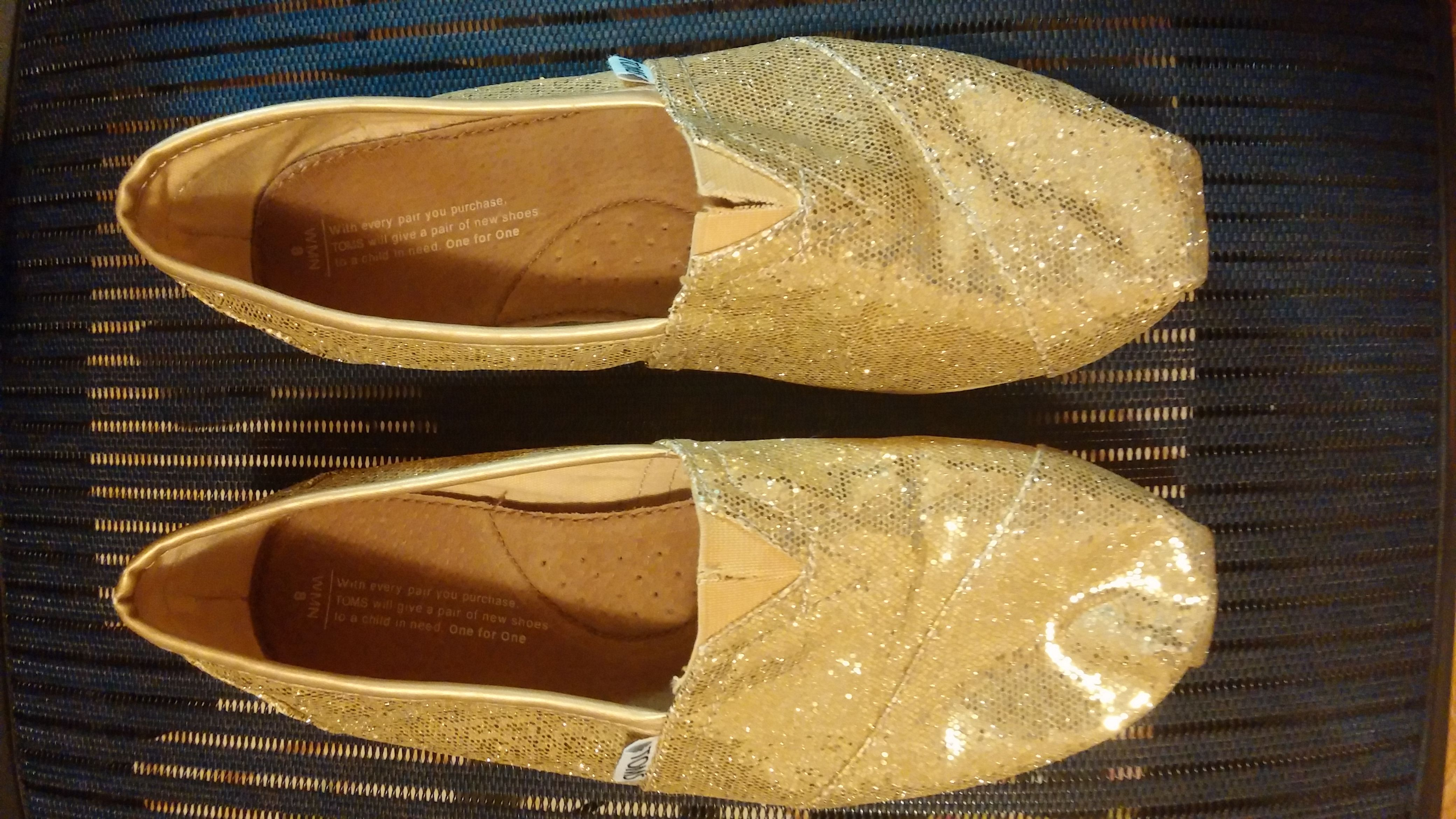 What could be better than these gold sequin Tom's? Reflective futuristic shoes that are probably sooo comfortable.