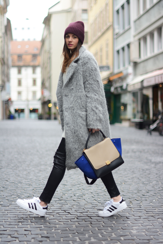 Geneva wearing Celine bag, adidas superstars, grey coat H&M ...