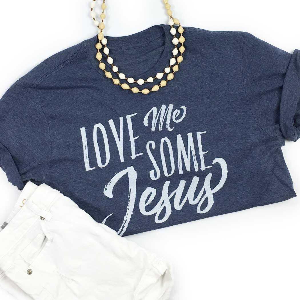 """Our """"Love Me Some Jesus"""" design on a vintage navy unisex t-shirt. FIT: This item is Unisex and runs True to Size. *Navy with vintage white design. Size Bust/Chest Inches XS 32-34 Small 35-36 Medium 37"""