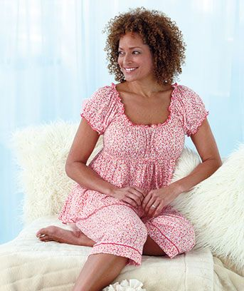 66aa8f6790a Plus-Size Knit Capri Pajama Set keeps you looking cute and comfortable. It  features a flirty ruffled trim on the elastic neckline and short sleeves  and a ...