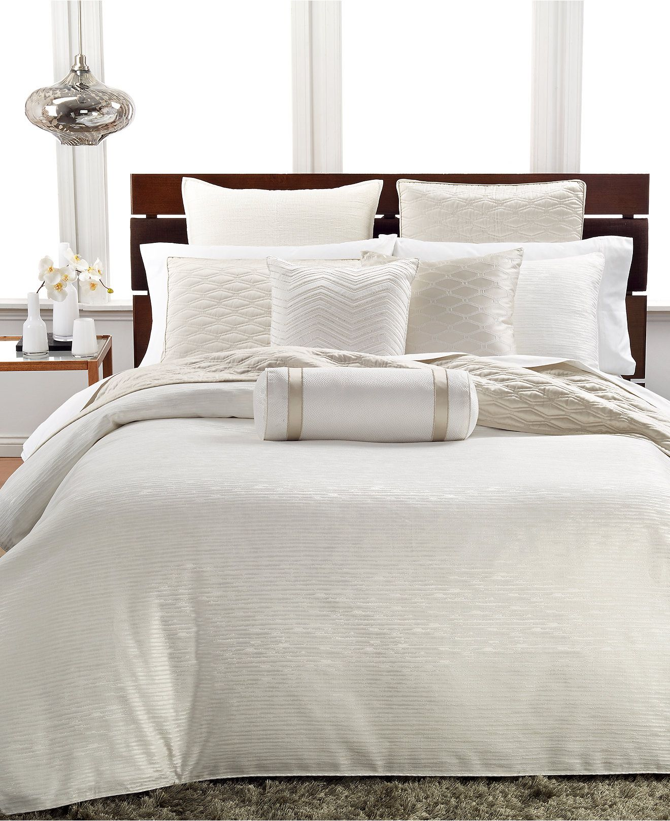 Dream in the luxury of this elegant comforter from Hotel Collection, featuring an ivory ground sporting a subtle woven texture. | Front: polyester/cotton. Back: cotton; polyester fill | Machine washab