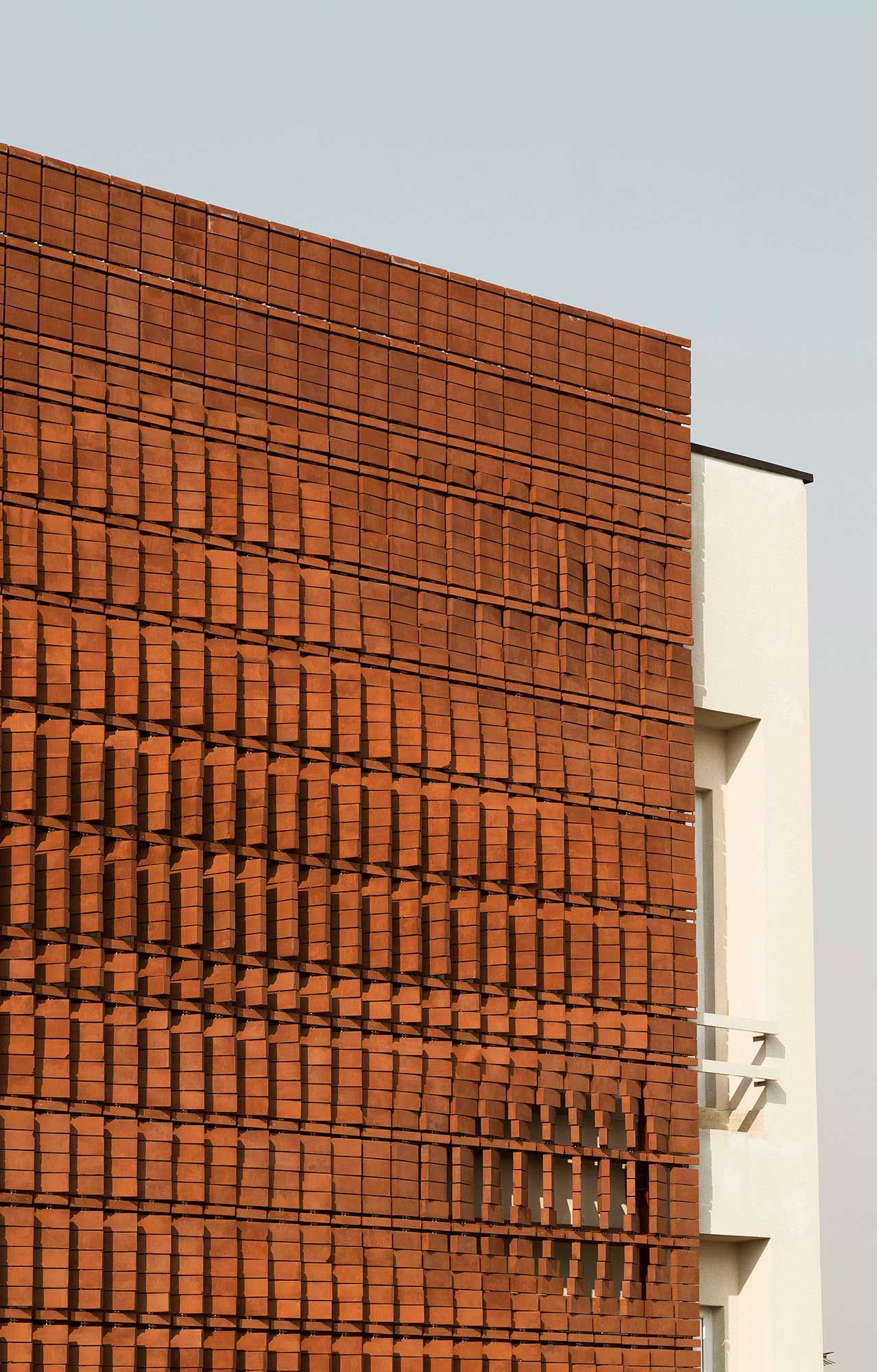 Cloaked in bricks by admun design construction studio yellowtrace