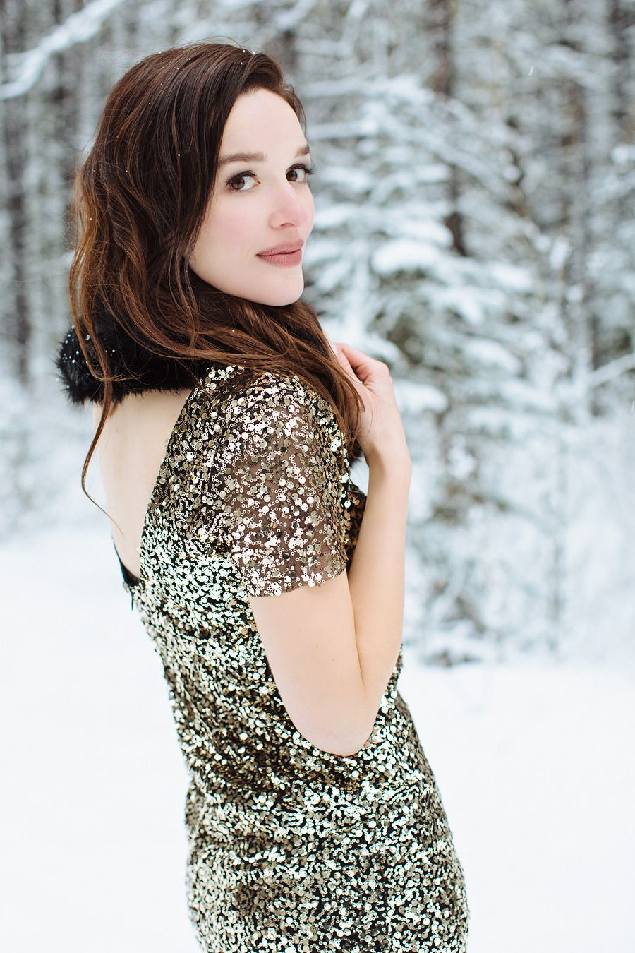 Sequins and the snow always make a good combination. Photography: Jacqueline Elizabeth Photography - www.jacquelineelizabeth.com Read More: http://www.stylemepretty.com/canada-weddings/2014/05/07/elegant-winter-engagement-session/