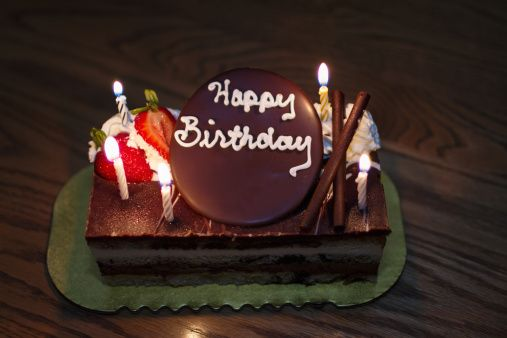 Chocolate cake with candles to celebrate the birthday - 4K stock video clip
