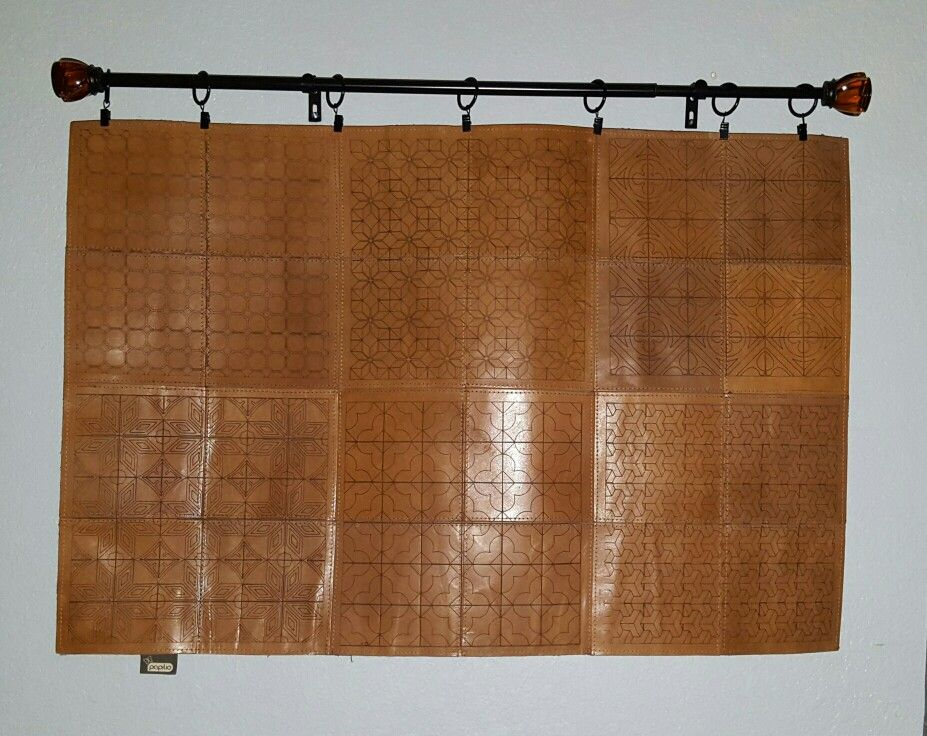 Hanging a leather rug.
