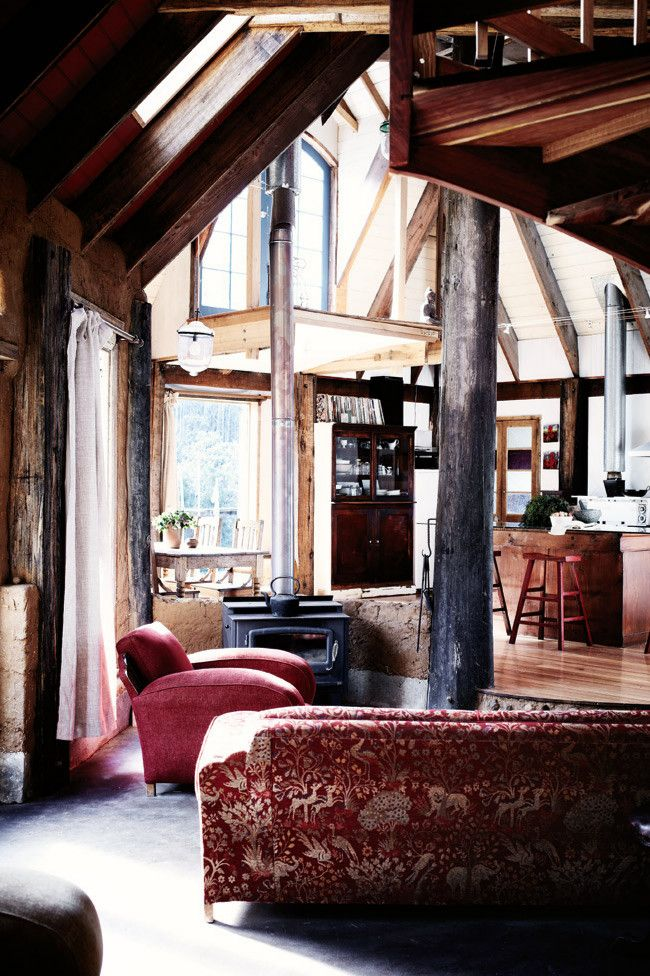 have exposed beams and a wood-fire stove
