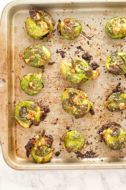 Garlic Parmesan Smashed Brussels Sprouts #smashedbrusselsprouts These Garlic Parmesan Smashed Brussels Sprouts are an easy side dish that will have any green veggie hater changing their minds! Great for your holiday spread, or to jazz up a weeknight dinner in under 30 minutes!   @sinfulnutrition   #sinfulnutrition   #sidedish   #vegetablerecipe   #brusselsprouts   #ThanksgivingSideDish   #HolidaySideDish #smashedbrusselsprouts