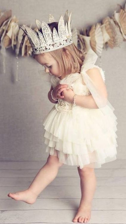 little girl with tulle dress and crown