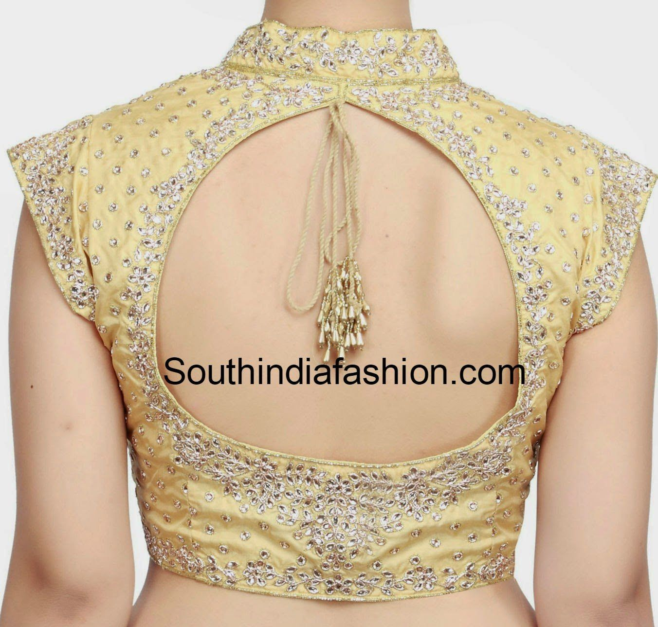 Collar Neck Kundan Work Blouse is part of Specific Styles Of Collar Neck Blouse Patterns Catalogue - Collar Neck Kundan Work Blouse   Gold stand collar neck kundan work blouse with front opening and cut out on the