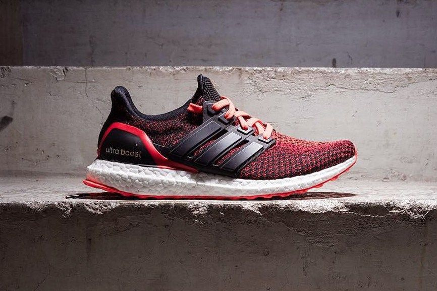 adidas Ultra Boost Solar Red Gradient features a Black and Solar Red color  scheme with a Gradient effect throughout the Primeknit upper with a White  Boost