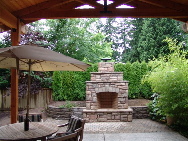 Outdoor Fireplace, Cultured Stone, Built Into Retaining