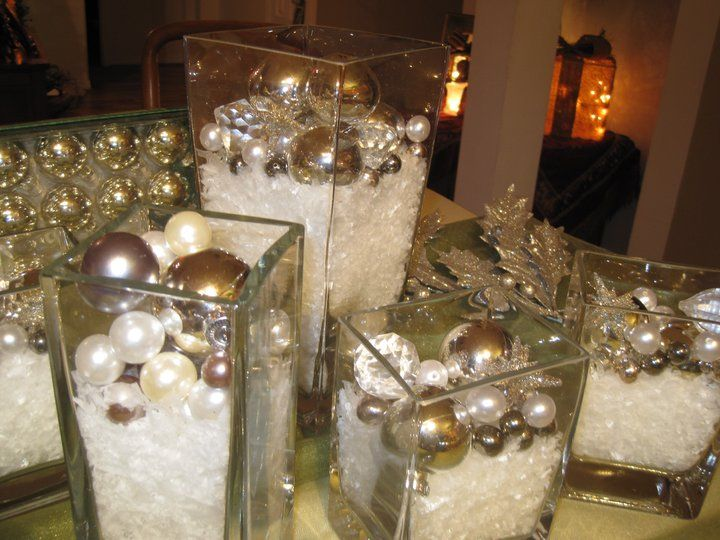 Glass vase filled with artificial snow and ornaments