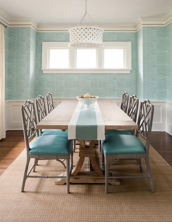 Gray Bamboo Dining Chairs With Turquoise Blue Leather Seat Cushions Flank A Trestle Dining Table And C Dining Table Chairs Aqua Dining Rooms Dining Room Design