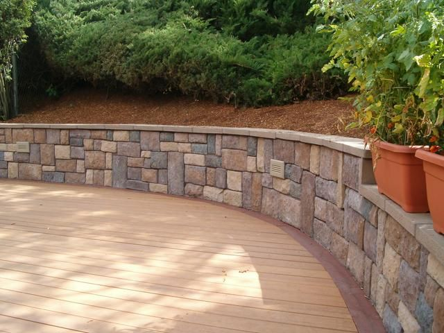 Building a patio on a hill with a retaining wall to for Patio and retaining wall ideas