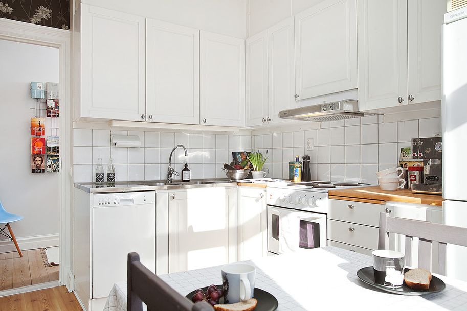 White kitchen with stainless steel and butcher board ...