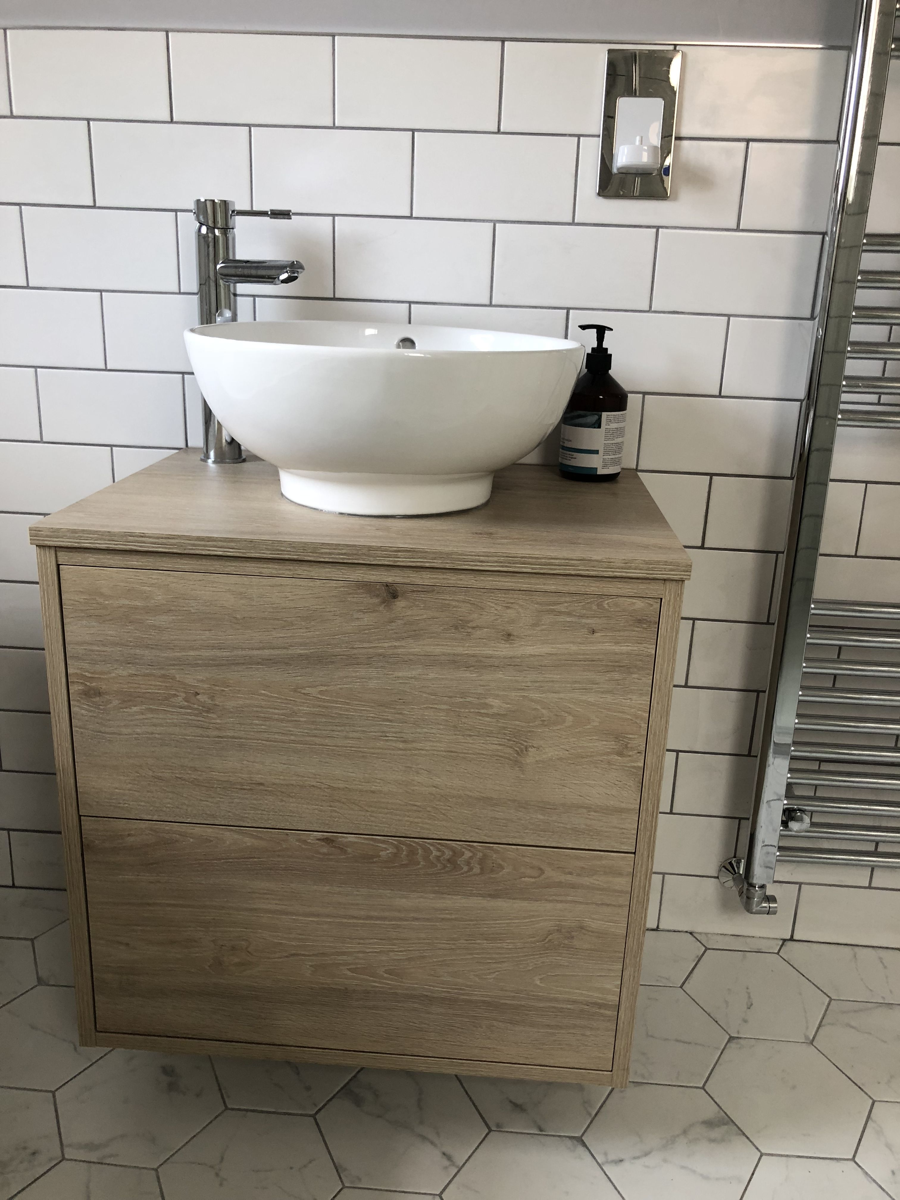 Wall hung vanity unit with standalone basin and tall mixer tap