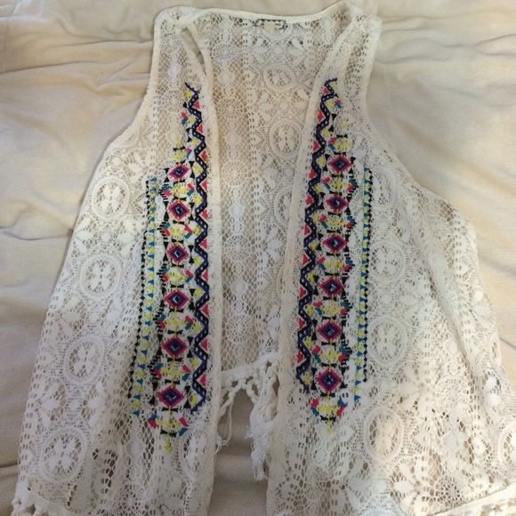 Sleeveless cardigan Sleeveless creme colored crotchet cardigan. With colorful tribal detail on the front. Super cute and easy to wear Sweaters Cardigans