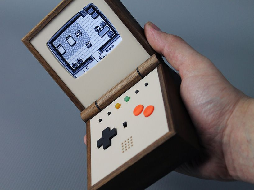 built around a system that emulates classic 8-bit portable gaming designs, the wooden console allows you to store over 10,000 games.