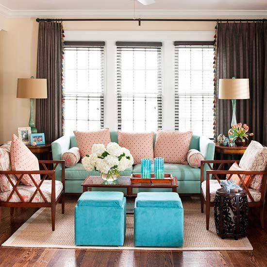 All Grown Up - Pink and blue aren't just for the nursery anymore. The colors look chic blended with rich brown and dark wood in this living space. The flirty polka-dot throw pillows and floral chair covers keep the space looking youthful and fun.