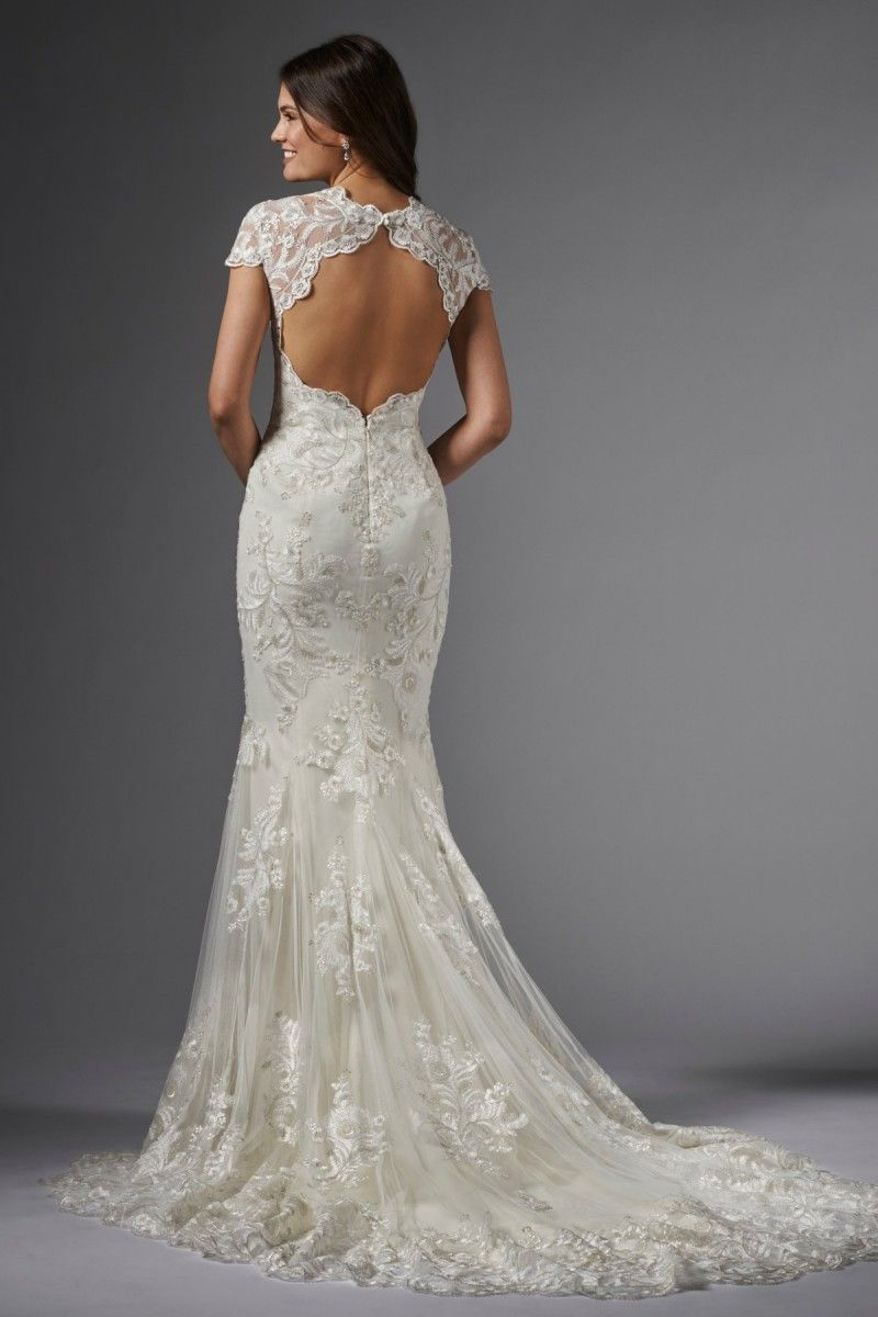 Slinky Wedding Dress With Cathedral Train Body Hugging Fit And Flare Gown Featuring Perfectly Placed Feather Lace Motifs Scallop Trim Sculpted Into