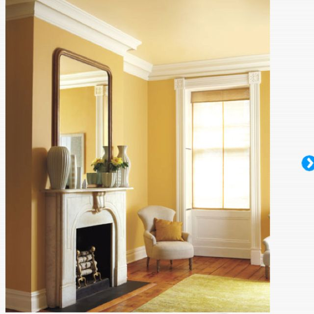 Love the colored ceiling and crown molding- so warm and inviting ...