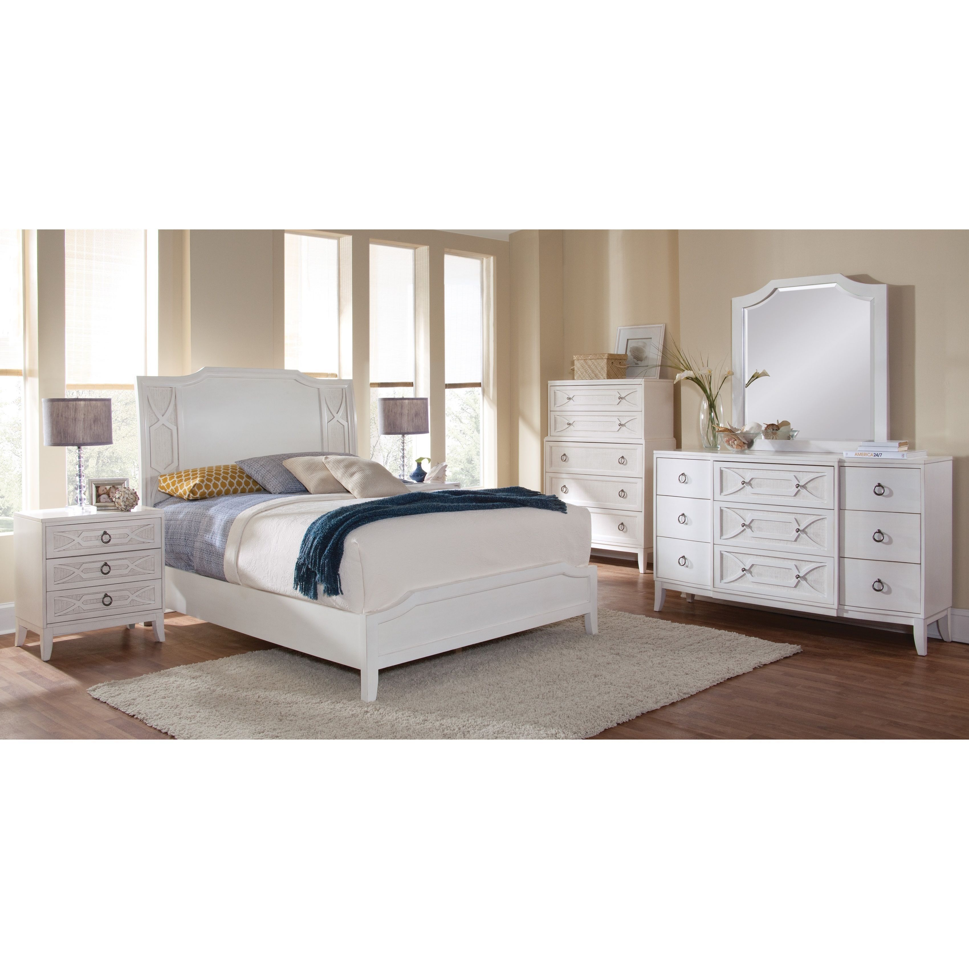 Enjoy the cottage charm of the Gladstone bedroom set. The antique white finish is accented by woven rattan insets and wooden fretwork. Durable construction with dovetail drawers, full extension glides and felt lined top drawers throughout.