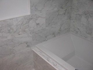 large subway-style marble tiles Carrara marble bathroom -  - bathroom - other metro - by Urban Bathrooms