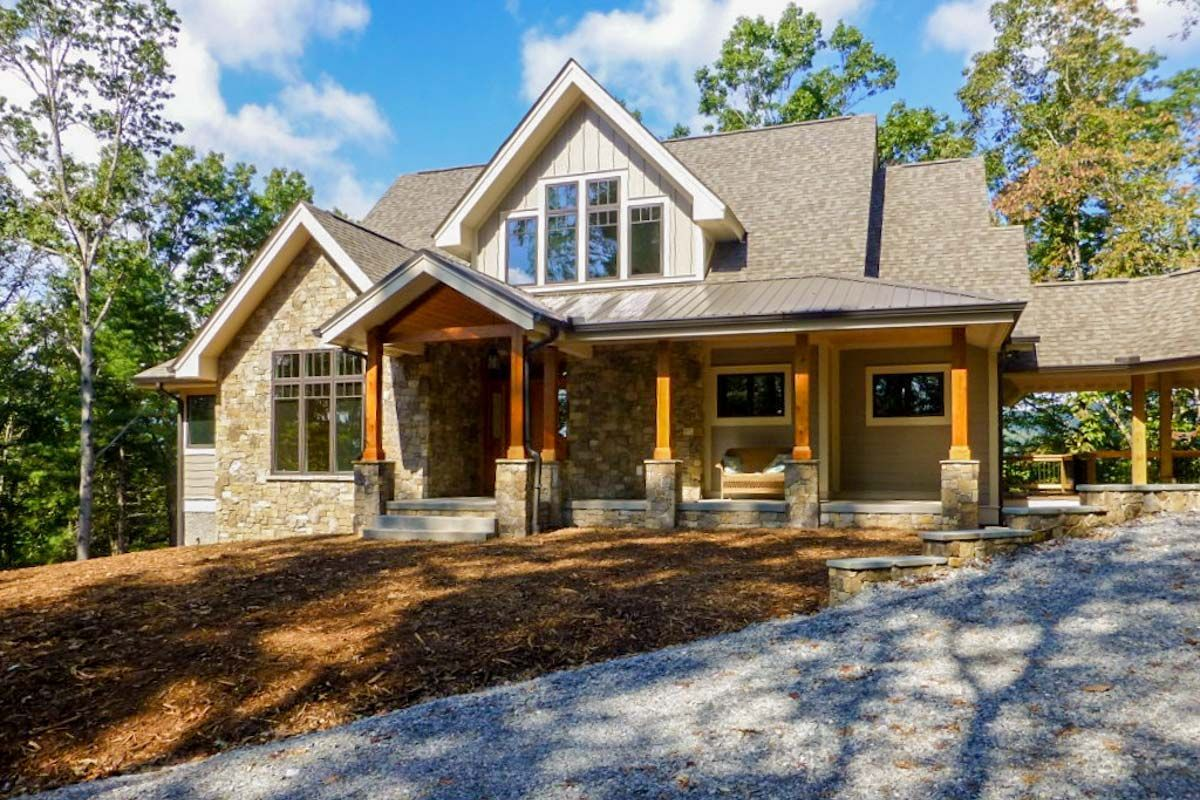 The rugged exterior of this Mountain home plan hides an attractive on dormer house plans designs, dormer windows inside house, dormer window seat design, mansard roof house design, shed dormer design, dormer pitched roof design,