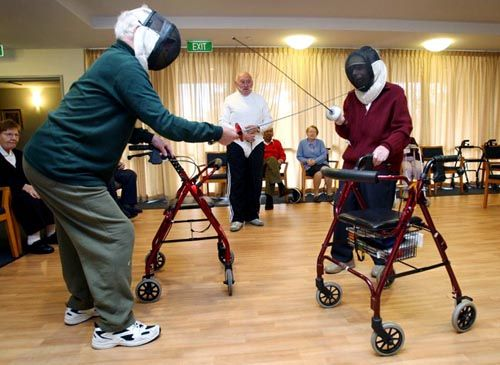 Senior Citizens Fencing With Walkers
