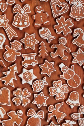 Various gingerbread cookies on wooden background.