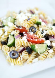 Greek Pasta Salad. This Greek pasta salad is a perfect make-ahead meal. You can toss all of the ingredients together, including the dressing, and it will be good for a few days if kept in an airtight container in the refrigerator. Once you have the noodles cooked and drained, all you need to do is quickly blend up the dressing and toss it together with the noodles, feta cheese, chopped cucumber, tomatoes, red onion and sliced black olives.