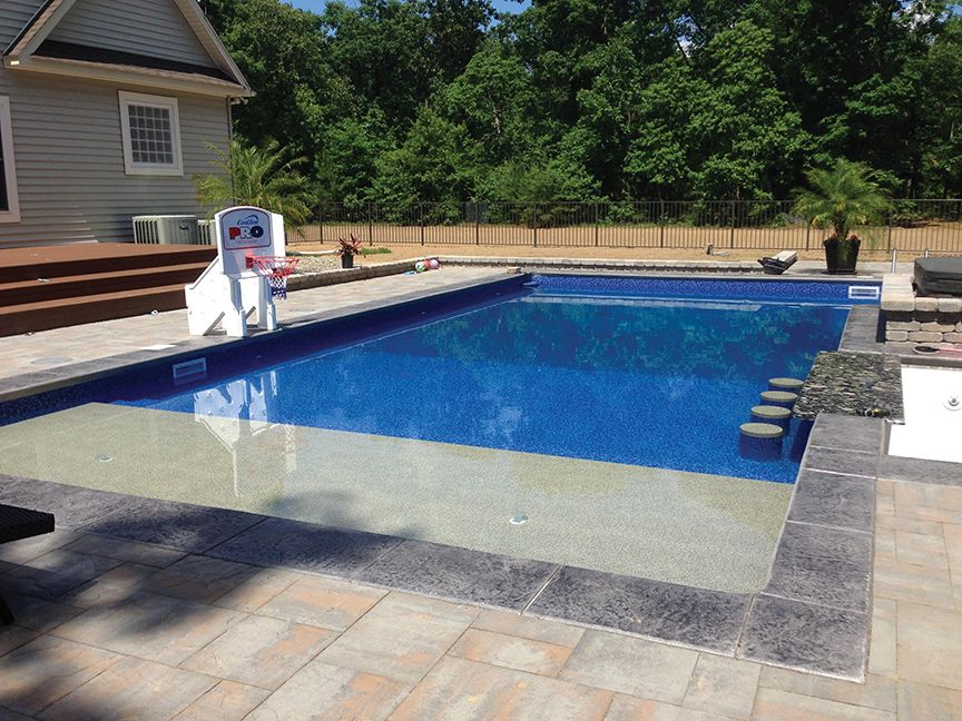 Radiant inground rectangle with sun ledge and built in bar for Built in pools