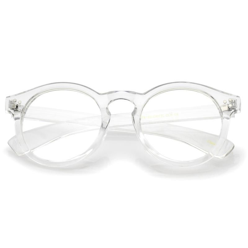 524c8ab4e51 P3 round eyeglasses featuring a translucent frame and round clear lenses.  Wide high sitting temples and a classic keyhole nose bridge.