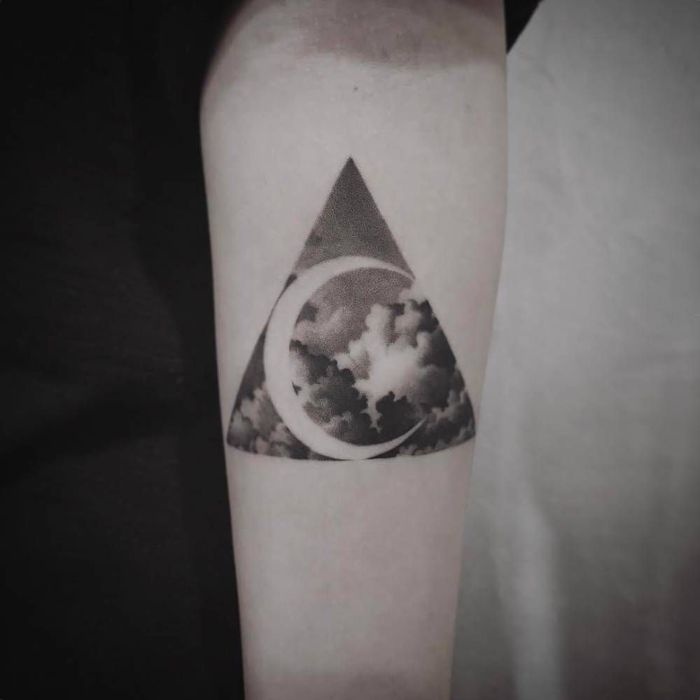 Negative Space Crescent Moon And Clouds In A Triangle Tattoo Arm