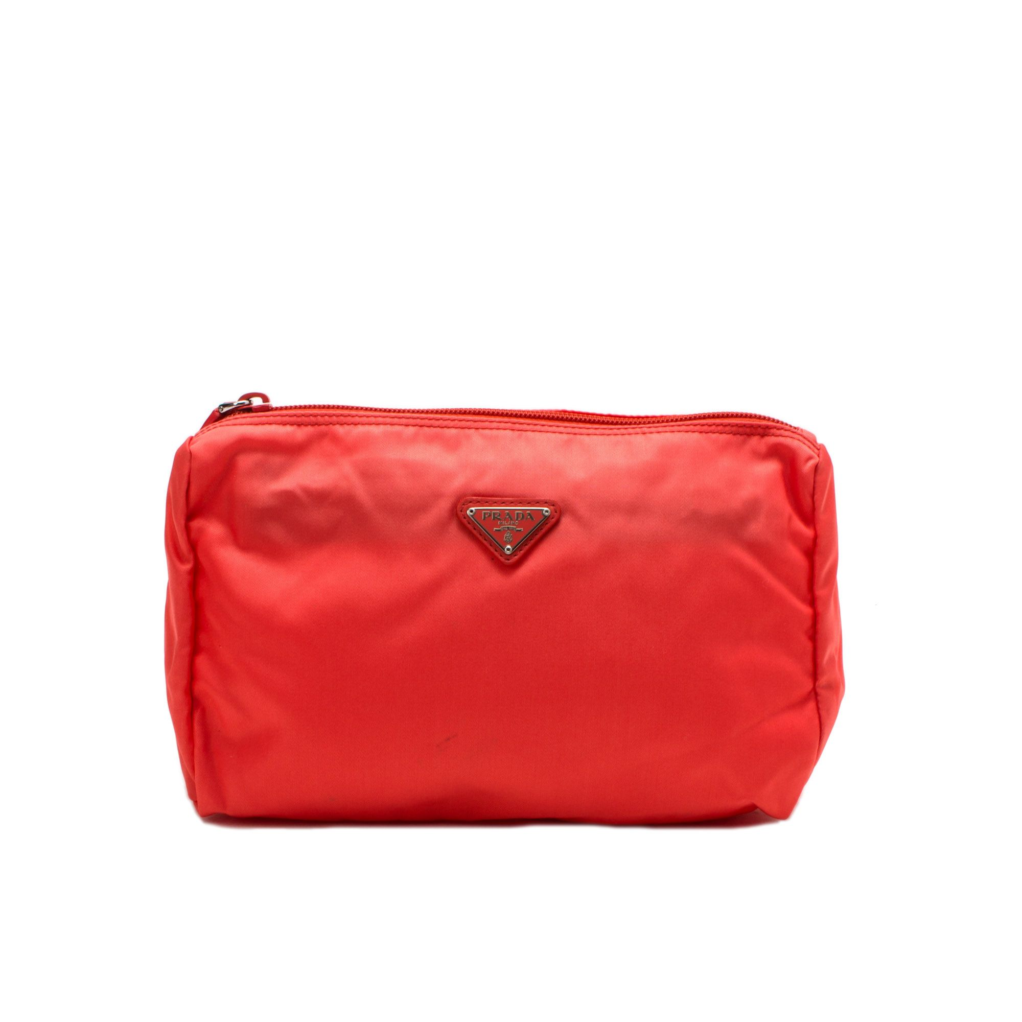 35cf3f26fcad91 Prada neon orange nylon #pouch. Available at lxrco.com for $129 ...