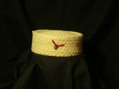 vintage cream colored pillbox hat from Famous Barr St. Louis.