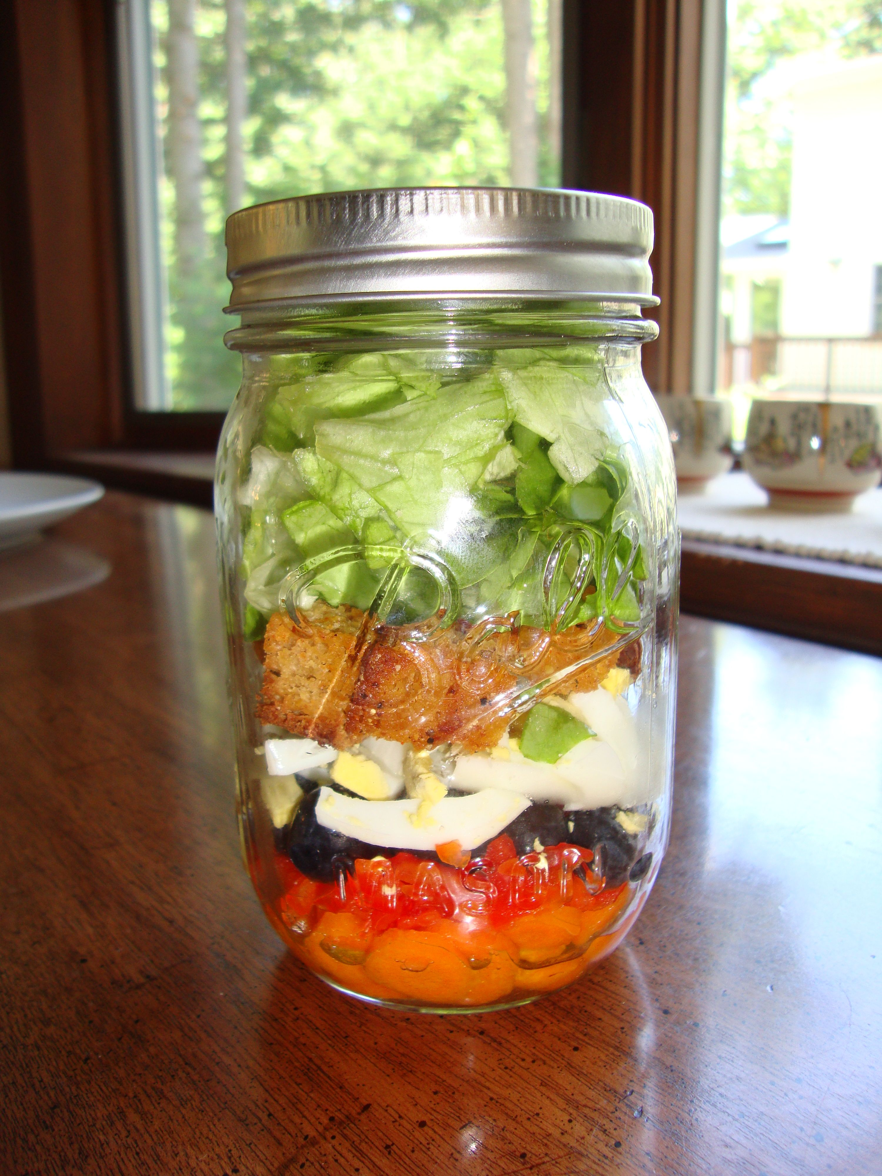 Rainbow salad in a mason jar.  bet I could replace the lettuce with spinach