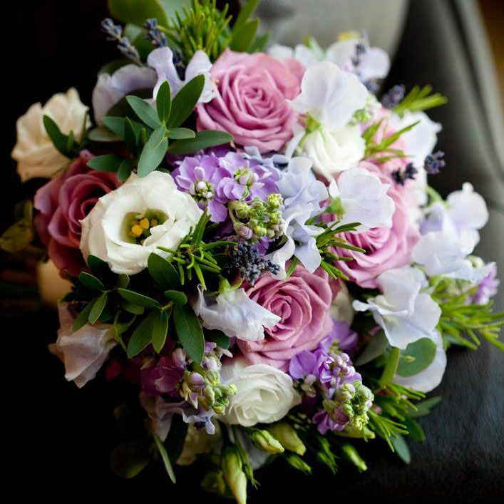 Mixed hand tied bouquet of Coolwater roses, lilac stock, sweet peas, lisianthus and parvi