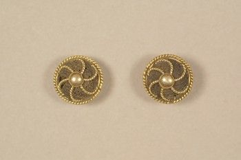 Pair of circular gold and hair cuff buttons, gold rope pinwheel design with inset of woven brown hair, gold post and circular guard on reverse.  Date:1850-1890