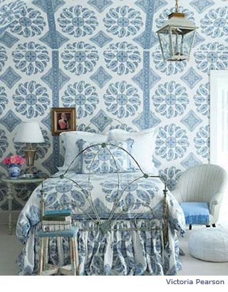 Bedrom with blue and white paisley walls and bedding - Victoria Pearsoon
