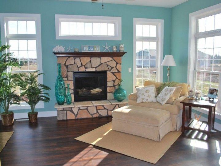 Stone fireplace in beach theme sun room living room - Beach theme decor for living room ...