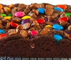 Choc Rainbow Squares: The colourful scattering of Smarties over these squares of slice will put a smile on any kid's face. http://www.bakers-corner.com.au/recipes/cakes/rainbow/choc-rainbow-squares/