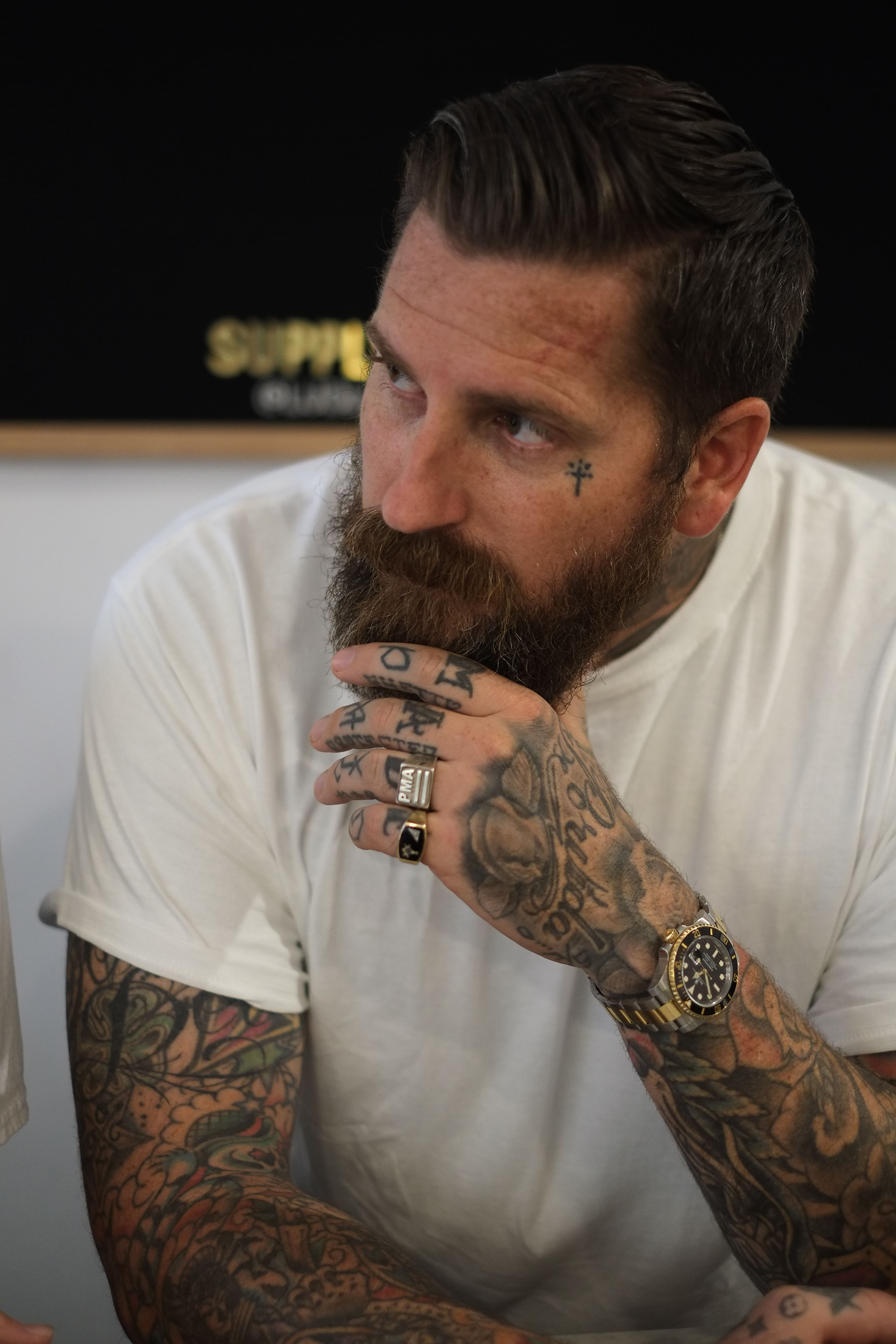Men 39 s hair luke wessman at a barber shop in lower east for Bearded tattooed man