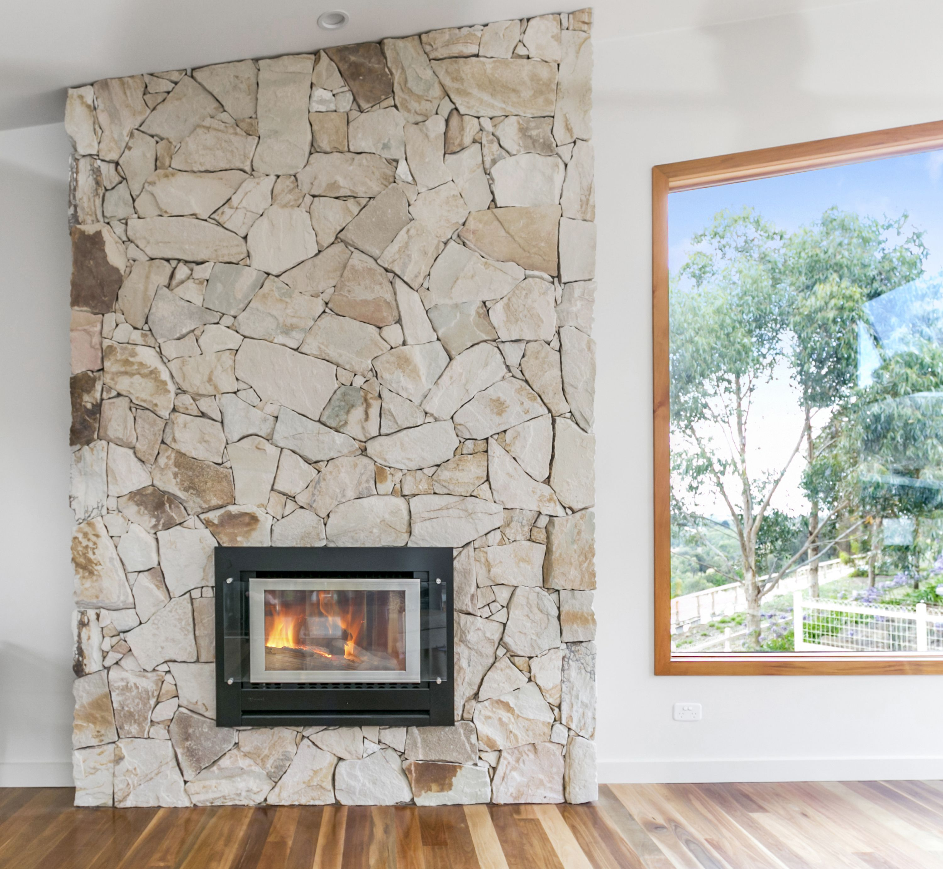 Eco outdoor crackenback sandstone free form indoor for Modern stone fireplace ideas