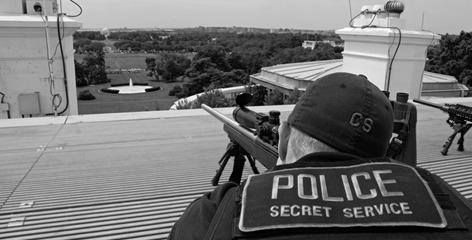 A US Secret Service sniper on  the roof of the White House.