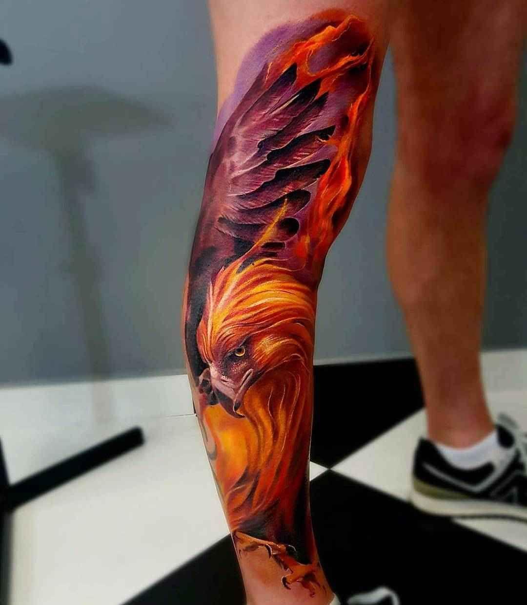 Tatuajes de ave fenix para hombres en la pierna