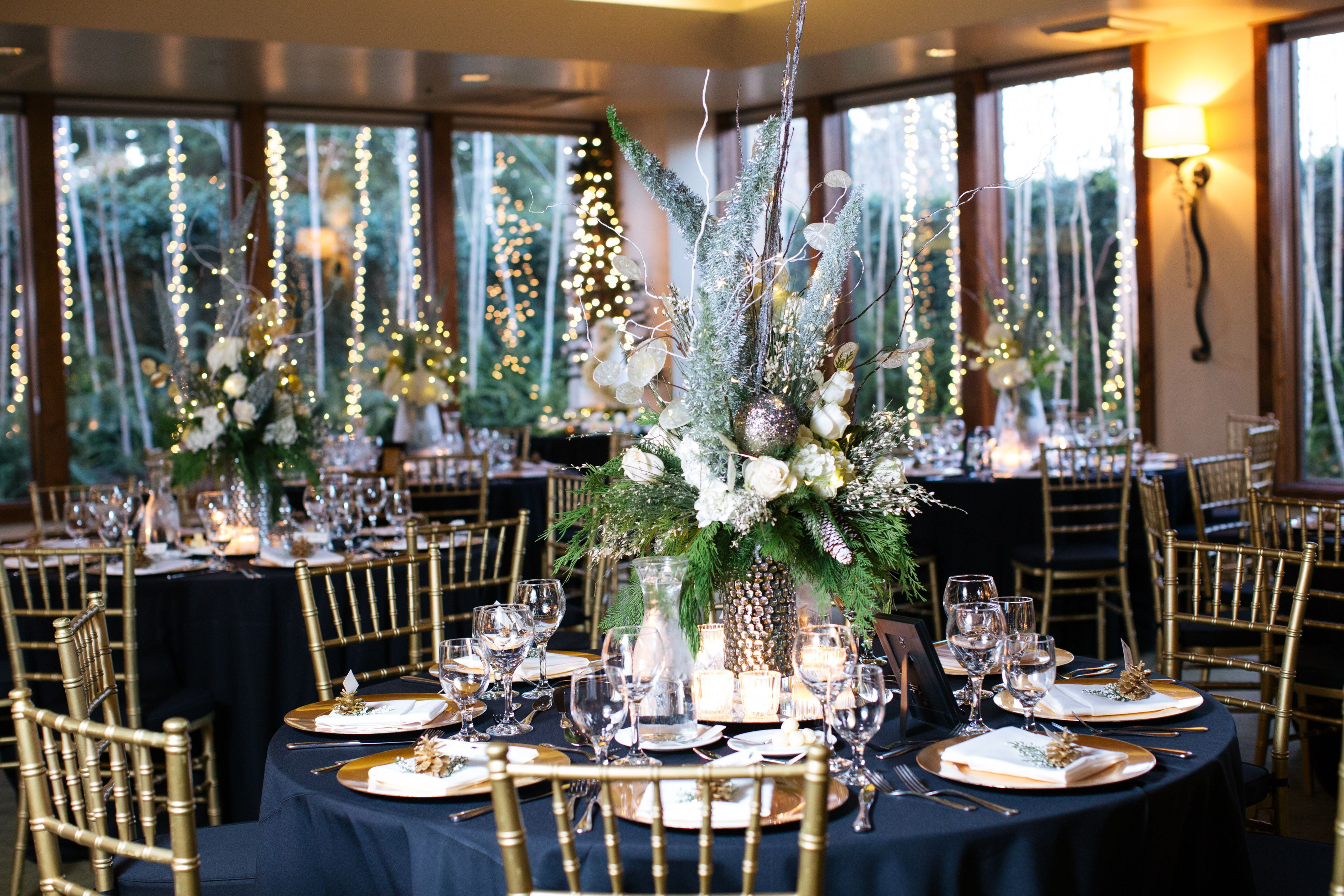 classic wedding table with navy gold and greenery. Winter